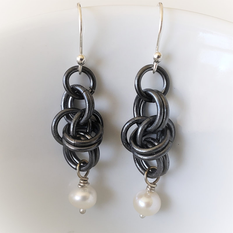 black earrings with freshwater pearls