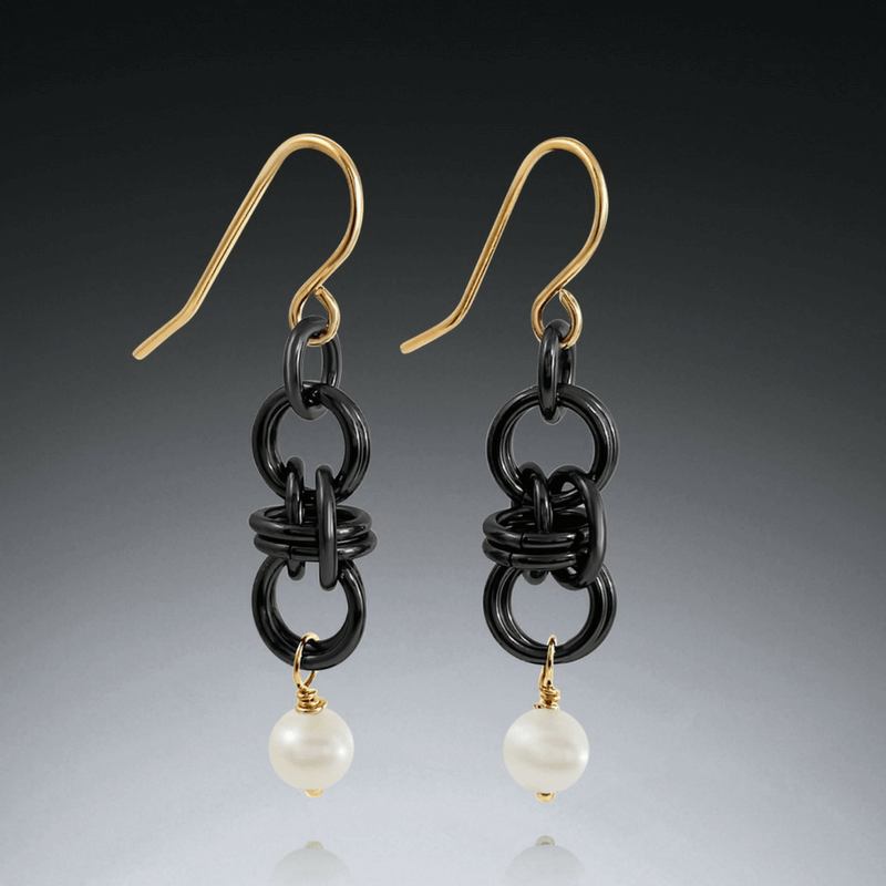Black and gold barrel earrings